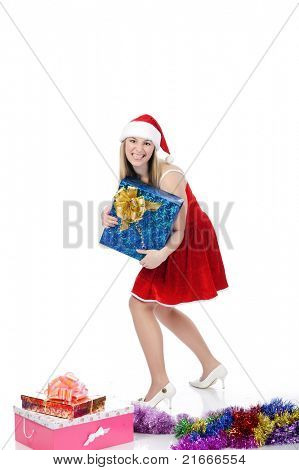 pretty young woman in red christmas clothing with a blue present box, isolated on white.