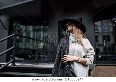 Portrait Of A Young Beautiful Fashionable Girl Wearing Sunglasses. Model In A Stylish Black Hat. Har