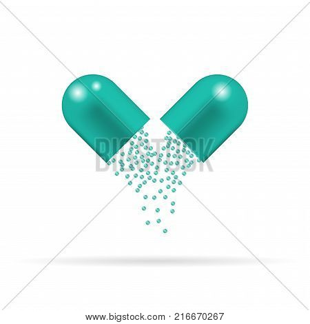 Capsule pill with green granules which are sprinkling and falling down. Tablet isolated on the white background.