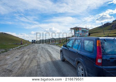 KEL-SUU, KYRGYZSTAN - AUGUST 11: Remote border checkpoint by the no man's land between Kyrgyzstan and China. August 2016