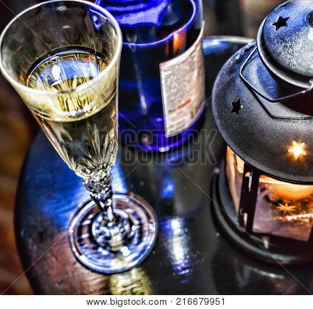New Year Christmas. Champagne In Glasses And In A Bottle, A Christmas Lantern With A Burning Candle