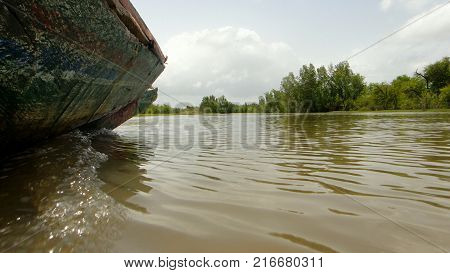 Boat sailing through the waters of the Gambia River