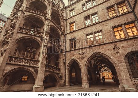 MUNICH, GERMANY - NOVEMBER 17, 2017: Historical courtyard of New Town Hall -Neues Rathaus- with gothic style arches on November 17, 2017. Munich is the 12th largest city in the European Union