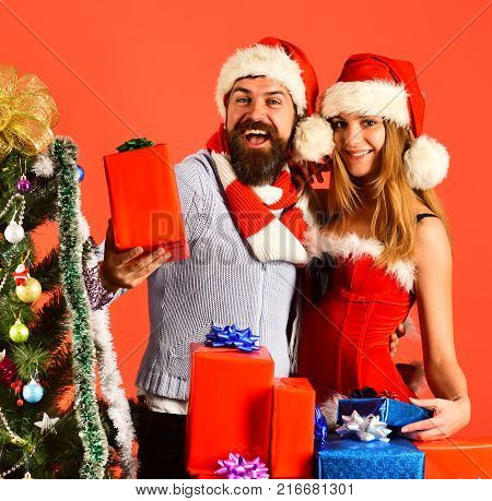 Mister And Missis Claus With Red And Blue Presents