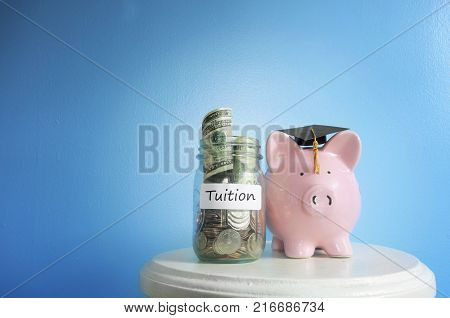 Piggy bank with graduation cap and Tuition coin jar