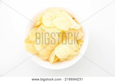 Crispy Thinly Sliced Potato Chips, On White Background.
