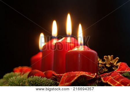 Red Candles Of An Advent Wreath With Fir Branches