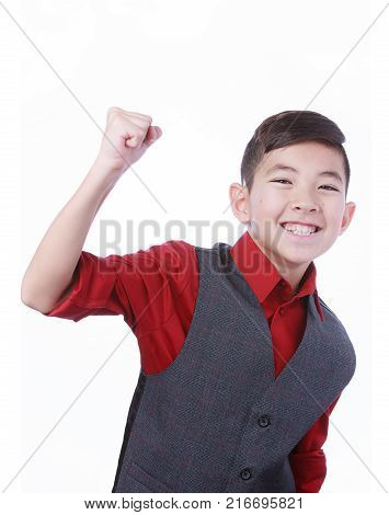 Excited boy makes fist pump. A happy young boy makes a fist pumping gesture.