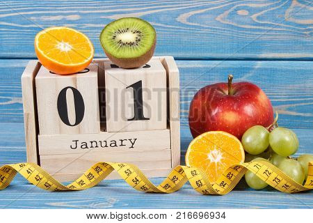 Cube Calendar, Fruits, Dumbbells And Tape Measure, New Years Resolutions Concept