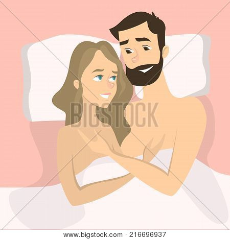 Happy smiling couple in bed lying naked.