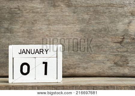 White block calendar present date 1 and month January on wood background Euro New year 's day