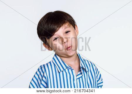 Happy studio portrait of a naughty boy