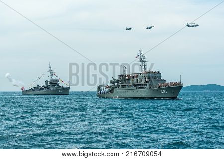 Pattaya Thailand - November 9, 2017 Navy warships running on sea while warplanes flying above warships on the 50th anniversary ASEAN international fleet review 2017 drill in Pattaya Thailand