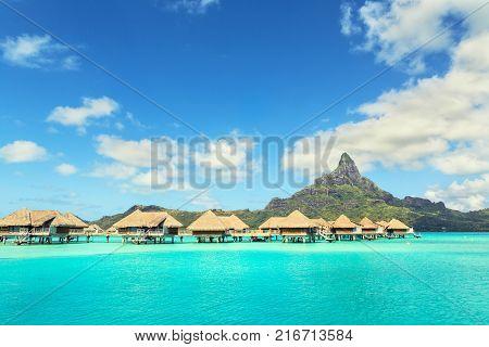 Otemanu mountain and luxury bungalow at Bora Bora island Tahiti French Polynesia