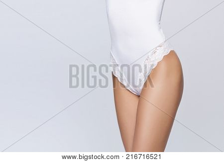 Sporty and sexy female body. Liposuction, nutrition, weight loss concept