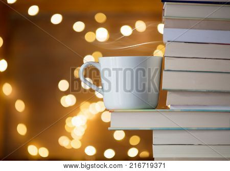 Pile Of Books And Blackboard With Fairy Lights