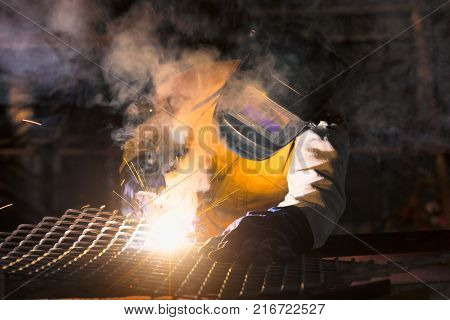 Welder-Worker welding and cutting steel in workshop of construction site with Oxy-Propane cutting and welding to steel part by manual