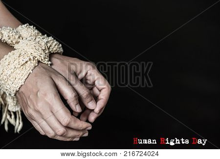 Stop violence against women hands were tied with a rope. Violence Terrified Human Rights Day concept.