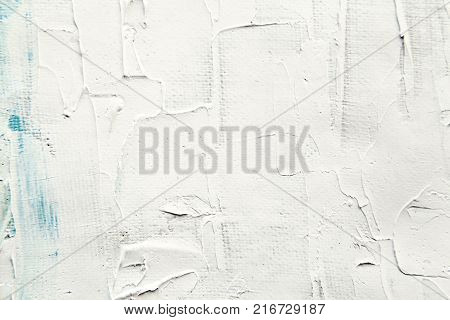 White painting surface close-up texture. Oil paint on a canvas abstract background