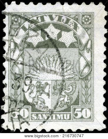 LATVIA - CIRCA 1923: A stamp printed in Latvia shows Latvian Coat of Arms, circa 1923