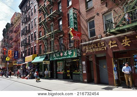 NEW YORK CITY USA - AUG. 23 : Facades of house and shops in China town on August 23 2017 in New York City NY. Manhattan is the most densely populated borough of New York City.