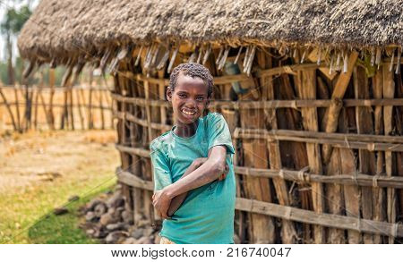 ADDIS ABABA, ETHIOPIA - MAY 1, 2015 : Ethiopian young boy in front of his home.