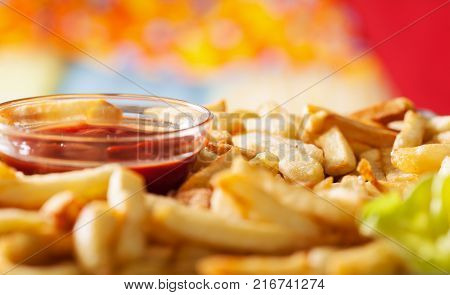 Delicious french fries and ketchup in a bowl - macro closeup bright lights