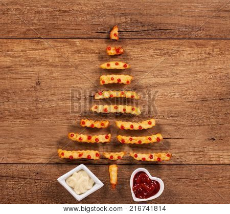 Merry christmas with french fries fast food xmas tree having ketchup drops decoration - copy space