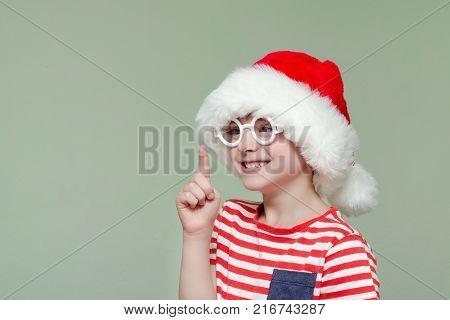 Boy In Santa Hat And Glasses Threatens Finger