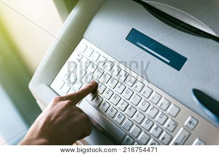 Modern Filter Over Woman Finger Pressing The D Letter Button On The Metallic Keyboard Of Atm Automat