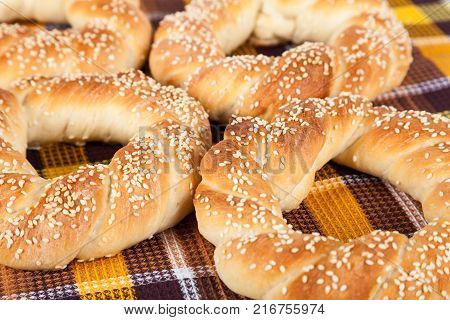 Freshly baked homemade simit with sesame seeds closeup
