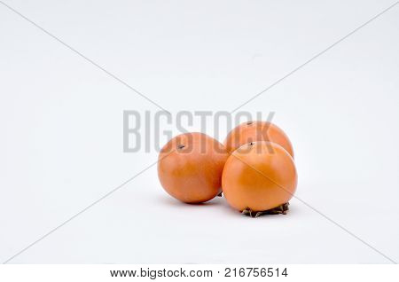 Persimmon southern fruit of orange-red colorsweet and astringent to taste