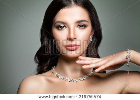 Beautiful Woman with Jewelry Diamond Necklace. Perfect Face
