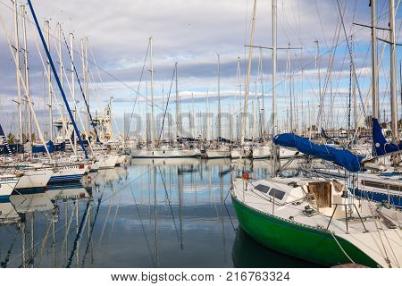 PALERMO ITALY - NOVEMBER 29 2017: Boats and yachts parked in La Cala bay old port in Palermo Sicily Italy.