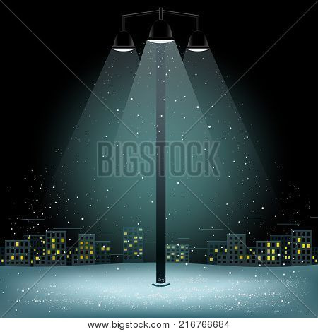 Christmas snow in lamp lights. Snowflakes falls on night city background. Big electric pillar with three lamps