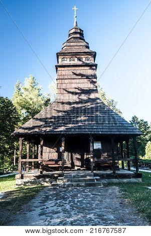 wooden church of sv. Prokop and Barbora in Kuncice pod Ondrejnikem village in Moravskoslezske Beskydy mountains in Czech republic during nice day with clear sky