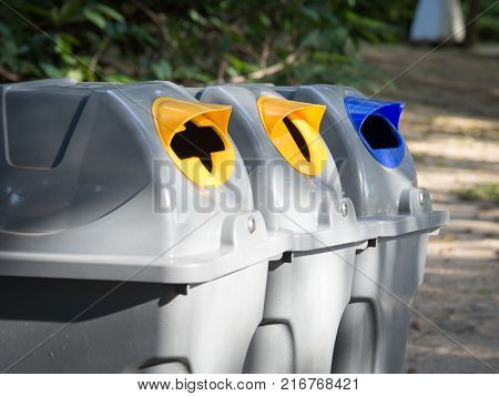 Gray bins for waste sorting are in the public park in bangkok thailand. recycle concept