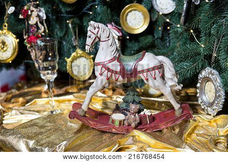 christmas decoration vintage horse on the background of a New Year tree on a table