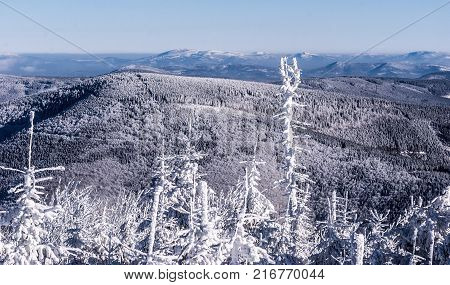 panorama of Beskids mountains with many hills snow and clear sky from Lysa hora hill in Moravskoslezske Beskydy mountains in Czech republic during winter frozen day