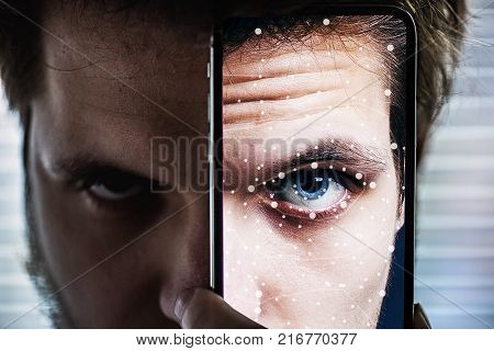 Smartphone using face ID. Identification and recognition system. Close up.