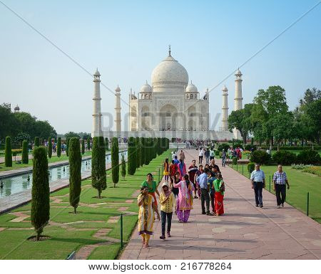 Agra India - Jul 13 2015. People visit Taj Mahal at sunny day in Agra India. The palace was commissioned in 1632 by Shah Jahan to house the tomb of his favourite wife.