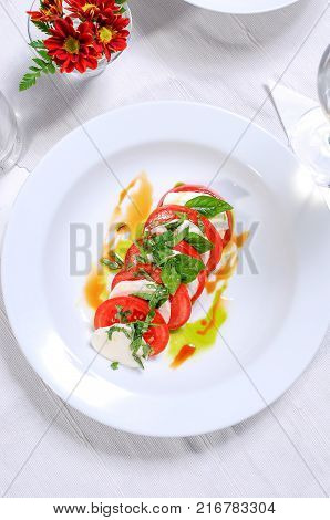 Fresh tomato salad with basil and cheese