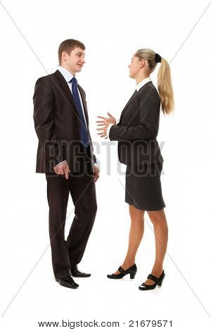 A businesswoman and a businessman are talking to each other - isolated on white background poster