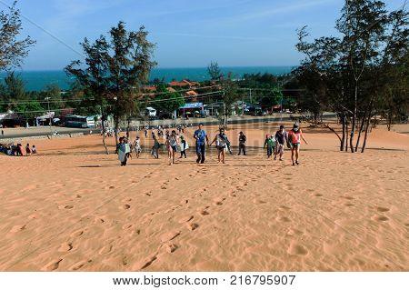 Tourists Walking Around Red Sand Dunes  Mui Ne In Vietnam