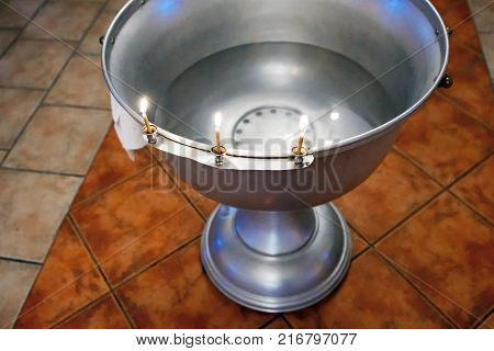 Bath sacrament of baptism in the Christian. Baptismal Font - a large bowl-shaped receptacle. Church utensils for the sacraments and rites.