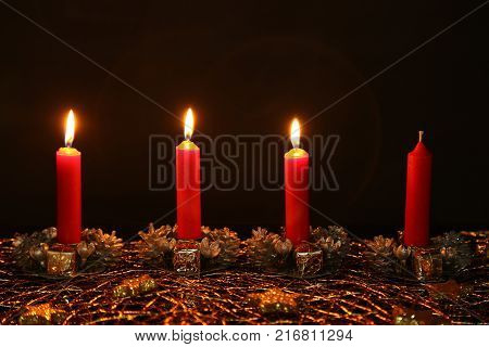 Advent Season, four candles burning. Advent background.