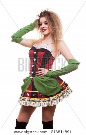 Beautiful entertainer girl in casino type outfit over white background in studio photo. Chance and risk. Gambling and winning
