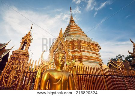 Buddhist Wat Phra That Doi Suthep Temple at the sunset. Tourists favorite landmark in Chiang Mai Thailand.