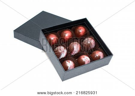 Chocolate candies in giftboxes isolated on white background. Assorted chocolates confectionery in their gift boxes. Set of colorful chocolate bonbons