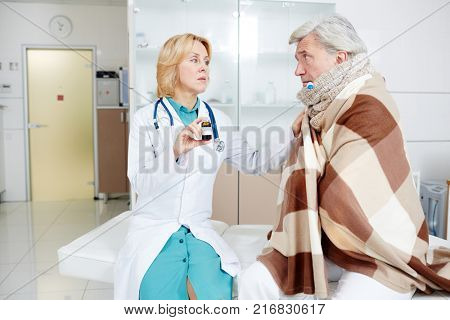 Modern clinician recommending new effective pills to her sick patient